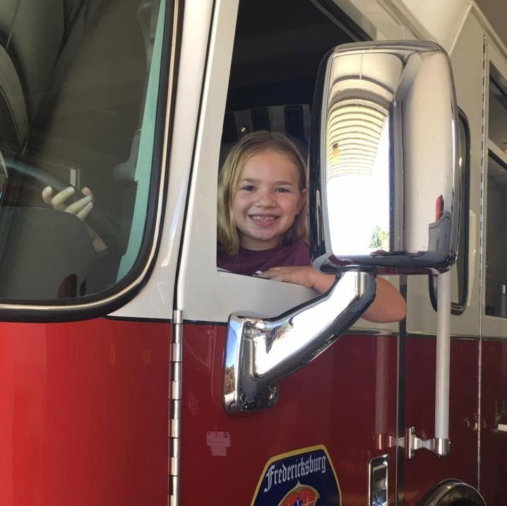 Girl in fire truck