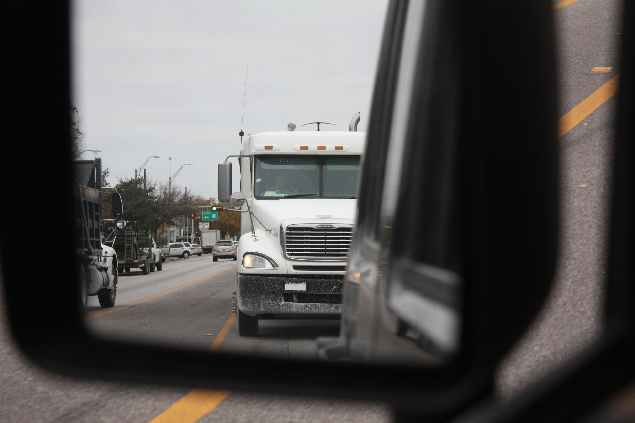Truck in side view mirror